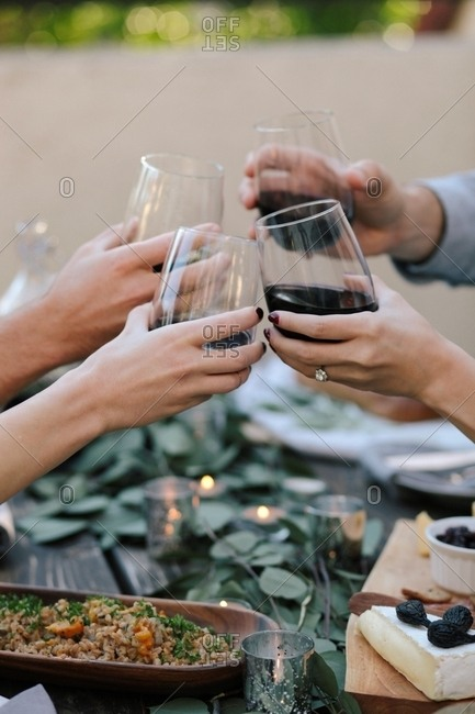 People toasting with glasses of wine