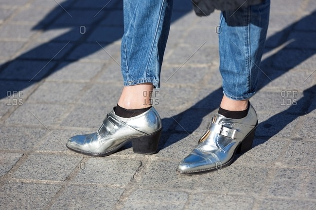 Woman wearing silver booties