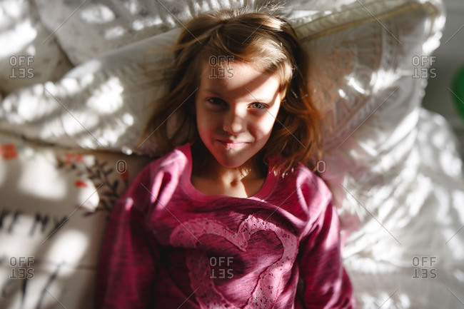 Girl in a bed in contrasted light