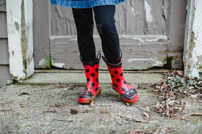 A girl in ladybug boots