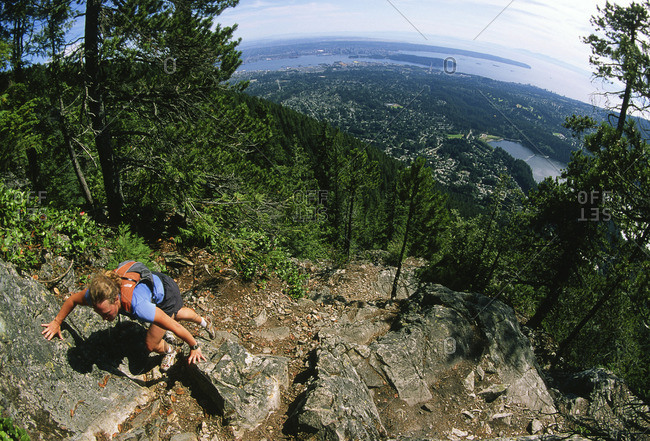 North Vancouver, British Columbia, Canada - August 15, 2007: Woman at the top of the Grouse Grind