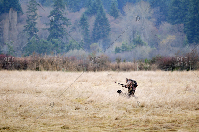 A man and his black lab hunting near Cowichan Bay, BC