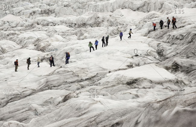 Alberta, Canada - August 21, 2011: Ice walkers on the Athabasca Glacier, Columbia Ice fields, Jasper National Park