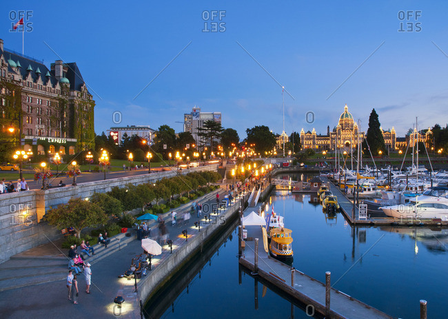 Victoria, British Columbia, Canada - August 21, 2013: The Inner Harbor of Victoria is a picturesque walkway along the water, framed by the BC Legislative Assembly building and the Empress Hotel