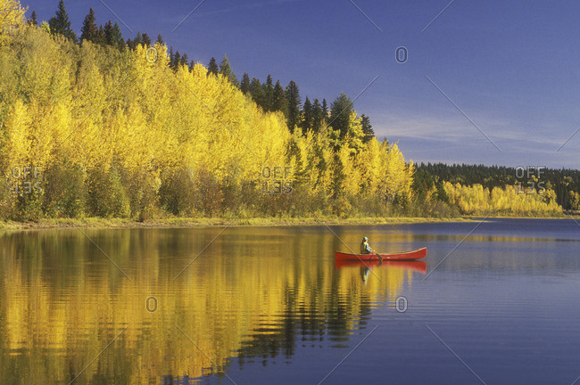 Solo canoeing on Morehead Lake, British Columbia, Canada