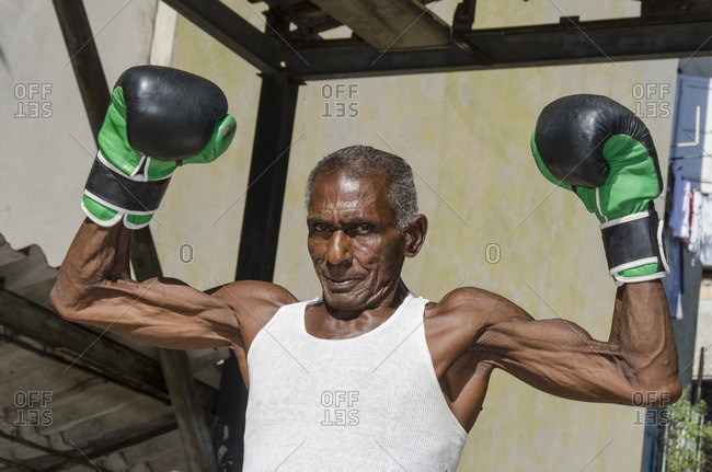 Havana, Cuba - October 10, 2013: Mid sixties male boxer at Rafael Trejo Boxing Gym, Habana Vieja