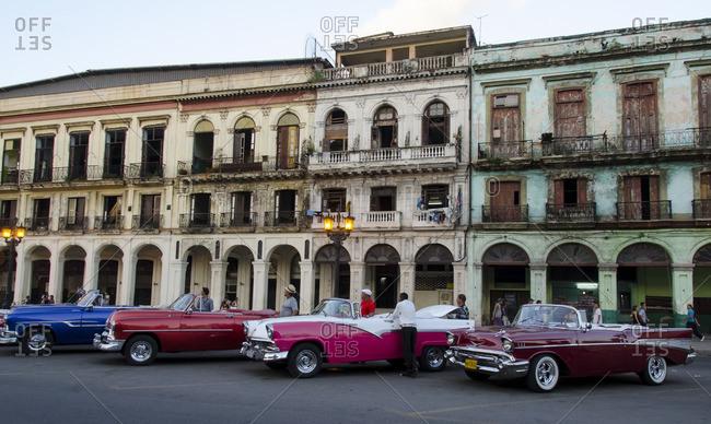 Havana, Cuba - October 10, 2013: Classic american cars and old building facades