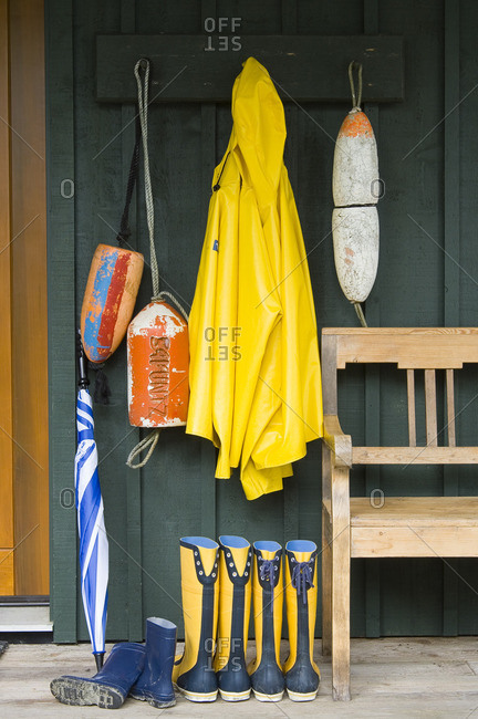 Yellow raincoats and boots outside Middle Beach Lodge, British Columbia, Canada