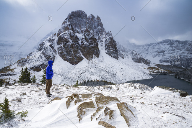 Mount Assiniboine Provincial Park, British Columbia, Canada - September 30, 2013: Hiker at the Nublet, with Sunburst Peak in the background