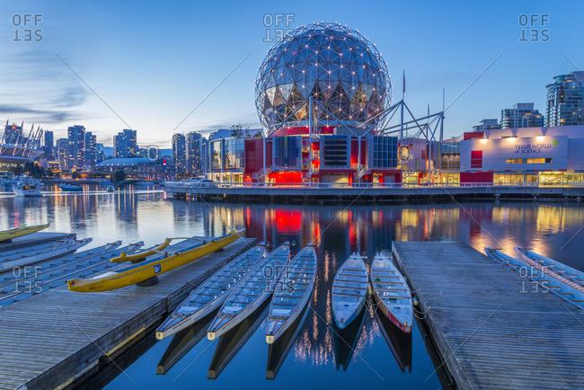 Vancouver, British Columbia, Canada - June 29, 2013: Telus World of Science and dragon boats, False Creek