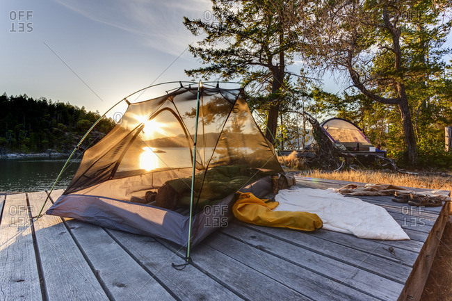 The sun sets through a kayaker's tent on West Curme Island Desolation Sound Marine Park, British Columbia, Canada