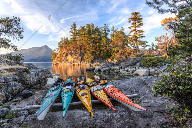Desolation Sound Marine Park, British Columbia, Canada. - June 15, 2015: Kayaks rest just above the high tide mark on West Curme Island