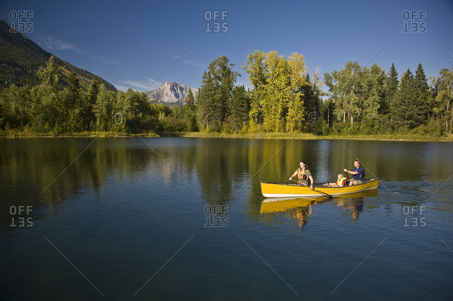 Elk Valley, British Columbia, Maiden Lake, Fernie - September 17, 2008: Young family canoeing on Maiden Lake with Mount Hosmer in background