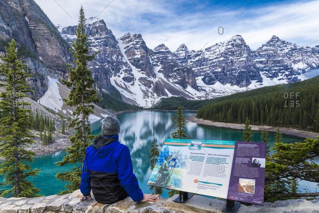 Alberta, Canada - June 13, 2013: Man at Moraine Lake viewpoint, Banff National Park