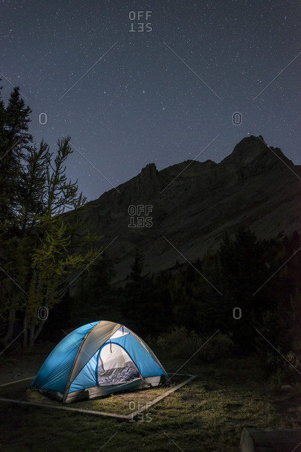 Camping under the stars at Baker Lake in the Skoki wilderness area of Banff National Park, Alberta, Canada