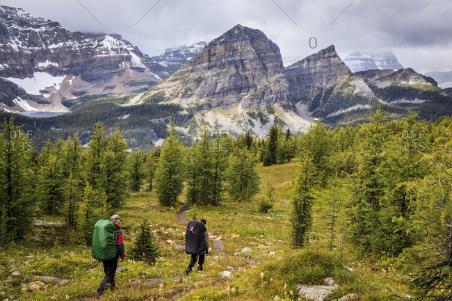 Banff National Park, Alberta, Canada - September 2, 2011: Two back packers descend the trail from Healy Pass to Egypt Lake