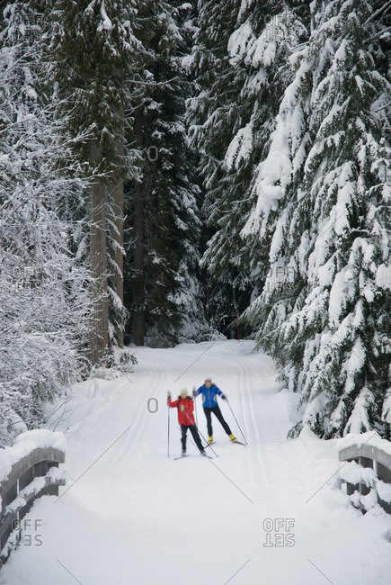 Cross country skiers Maria Lundgren and Akiko Clarke skate the trails at Lost Lake park in Whistler, BC