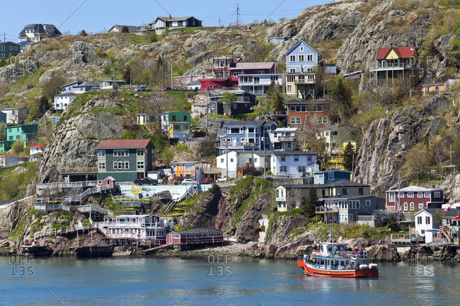 St. John's, Newfoundland, Canada - June 13, 2014: The Battery is a small neighborhood at the entrance to St John's harbor that is noted for its colorful houses built at the base of Signal Hill