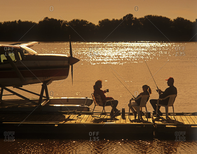 Manitoba, Canada - March 19, 2013: Family on float plane dock, along Red River