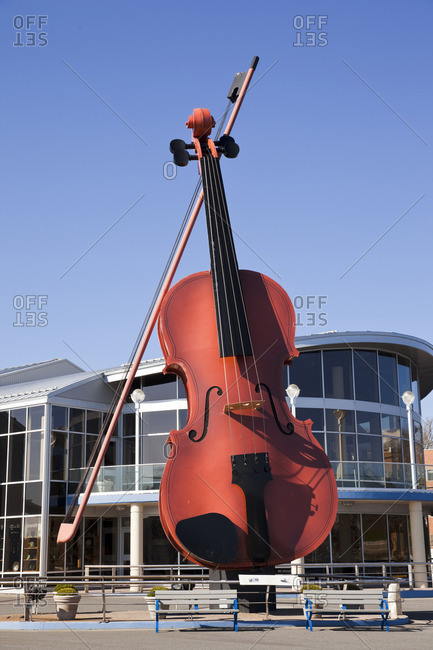 Sydney, Nova Scotia, Canada - May 28, 2014: Named Fidheal Mhor A' Ceilidh in Gaelic, The Big Fiddle of Ceilidh was designed and built by Cyril Hearn and erected at the Port of Sydney as a symbol of hospitality to cruise ship passengers