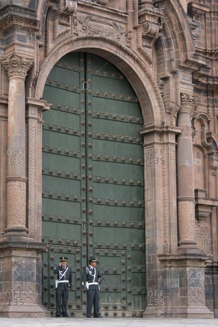 Cuzco, Peru - October 9, 2014: Policemen in front of Cusco Cathedral doorway