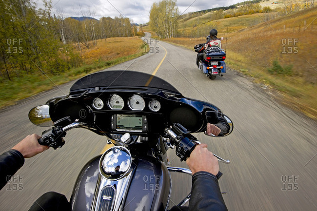British Columbia, Canada - October 8, 2013: Motorcyclists ride the road to Pinantan lake, near Kamloops, in the Thompson Okanagan region