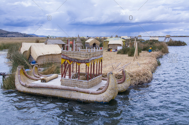 Uros, Lake Titicaca, Peru - October 7, 2014: Local residents of floating reed islands