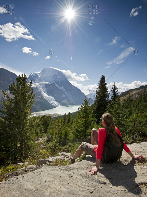 An attractive, young lady takes in the stunning view of Mount Robson, Berg Lake and Berg Glacier, in the Thompson Okanagan region of British Columbia, Canada