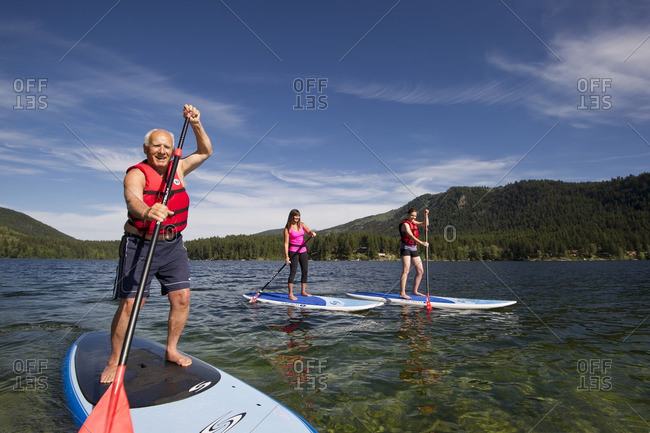 Heffley Lake, Thompson Okanagan, British Columbia, Canada - July 26, 2013: A group of paddle boarders enjoy a stunning day on the waters of Heffley Lake, North of Kamloops in the Thompson Okanagan region