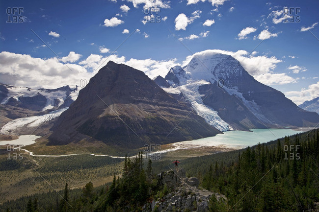 An attractive, young lady takes in the stunning view of Mount Robson, the Robson Glacier, Rearguard Mountain, Berg Lake and Berg Glacier, in the Thompson Okanagan region of British Columbia, Canada