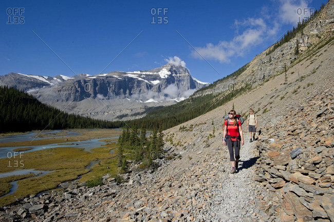 British Columbia, Canada - September 8, 2013: A young couple hike the Robson trail system of Mount Robson, just North of Valemount, in the Thompson Okanagan region