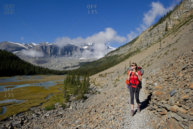 British Columbia, Canada - September 8, 2013: An attractive young lady hikes the Robson trail system of Mount Robson, just North of Valemount, in the Thompson Okanagan region