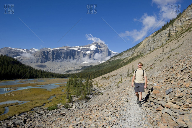 British Columbia, Canada - September 8, 2013: A young man takes in the stellar views as he hikes the Robson trail system of Mount Robson, just North of Valemount, in the Thompson Okanagan region