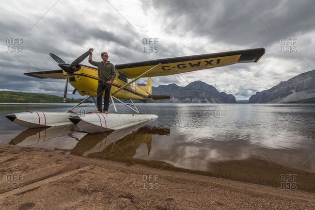 Northwest Territories, Canada - July 5, 2013: Float plane pilot standing on the floats at Little Doctor Lake