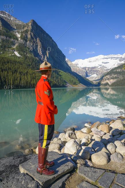 Lake Louise, Banff National Park, Alberta, Canada - July 4, 2014: RCMP Officer at Lake Louise, Banff National Park