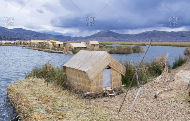 Local residents of floating reed islands of Uros, Lake Titicaca, Peru