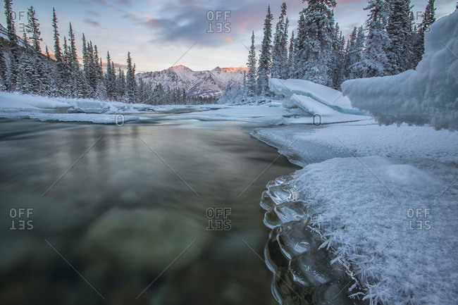 Ice forms on the Wheaton River as it flows towards the Gray Ridge in the distance