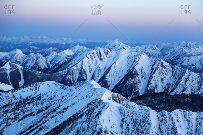 Aerial view of the snow capped Purcell mountains at dawn, British Columbia, Canada
