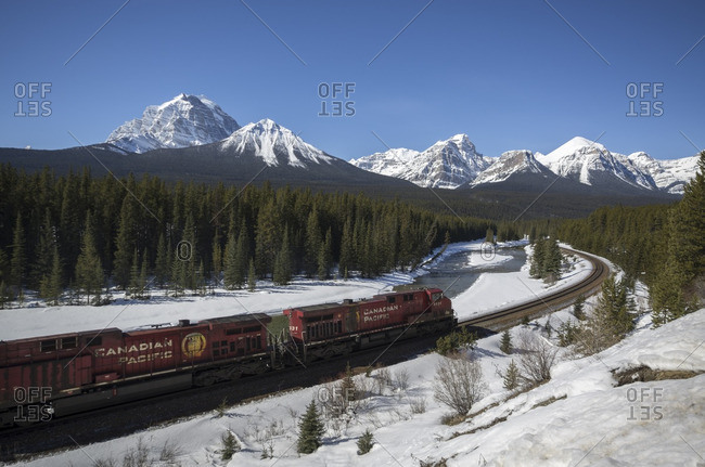 Banff National Park, Alberta, Canada - March 26, 2013: Canadian Pacific freight train on 'Mornant's curve' in the Canadian Rocky Mountains in Banff National Park