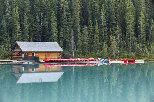 Banff National Park, Alberta, Canada - September 1, 2012: Boathouse and canoes reflection, Lake Louise