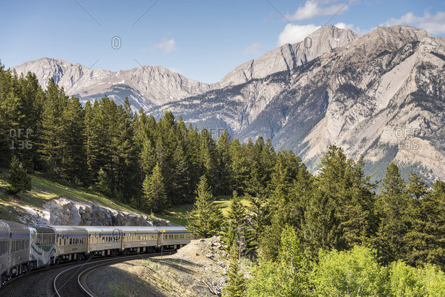 Passenger train going through the Rocky Mountains in Jasper National Park, Alberta, Canada