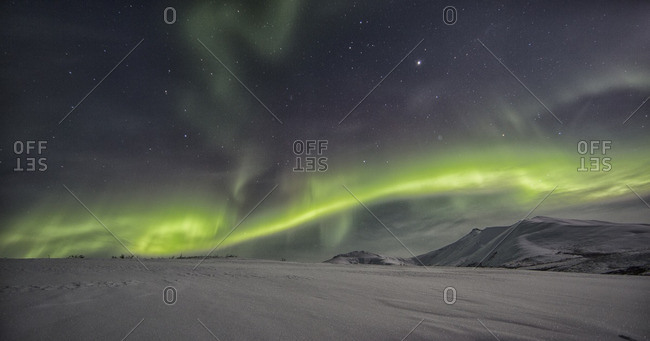 Northern lights or aurora borealis above the snow covered tundra along the Dempster Highway, Yukon