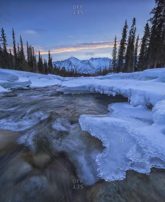The Wheaton River at sunrise as it flows towards Grey Ridge, near Whitehorse, Yukon