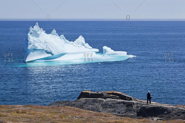 Women taking photos of iceberg off the coast of Bauline East, Newfoundland