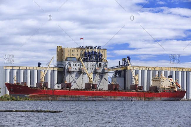 Thunder Bay, Ontario, Canada - September 13, 2013: Cargo ship loading grain on Lake Superior