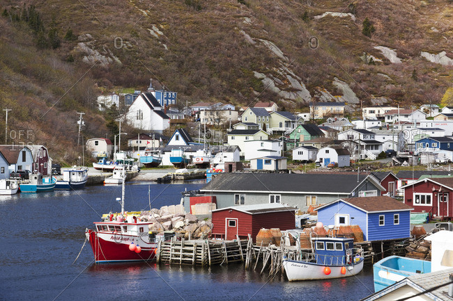 Petty Harbor, Newfoundland, Canada - June 13, 2014: Nestled deep in the heart of Motion Bay, Petty Harbor is a small town south of St John's that still relies heavily on fishing as it makes the transition to tourism-related services