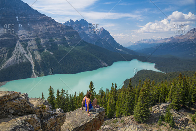 Woman on rock overlooking Peyto Lake, Banff National Park, British Columbia, Canada