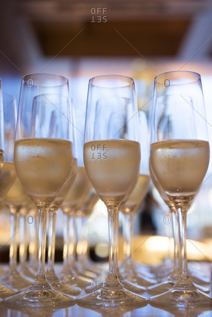 Rows of champagne glasses filled for a toast