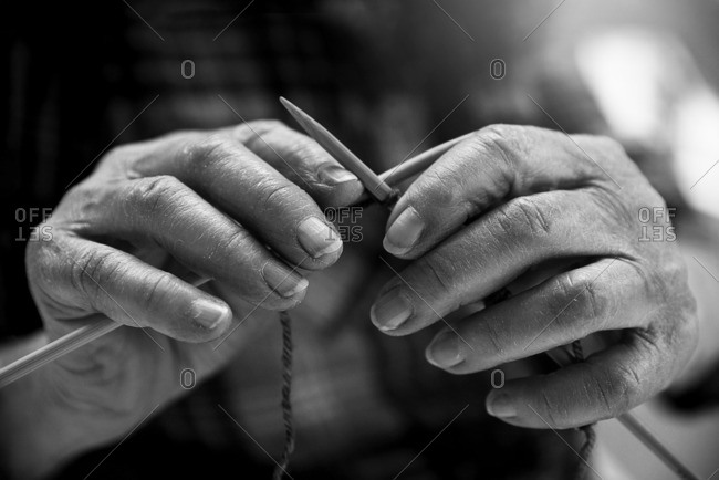 Close up of elderly lady's hands knitting