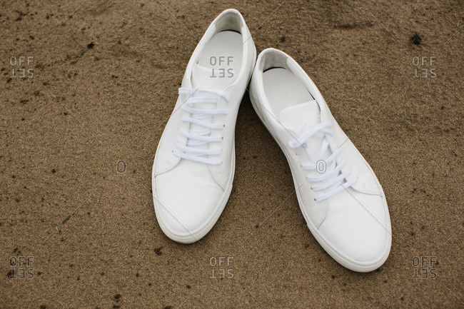 White shoes on sand